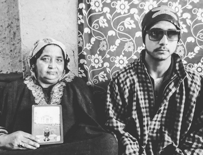 Pellet victim Hilal sitting beside her mother