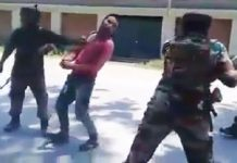 Army beating youth for keeping content related to militants