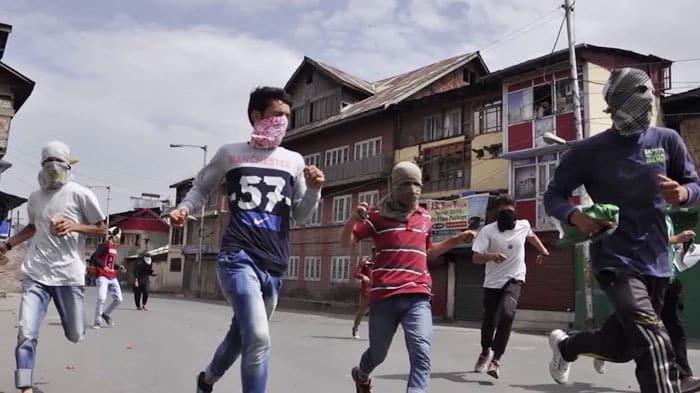 Kashmiri youth pelting stones