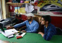Qamar-uz-Zaman filling a student's online form at Fida Dot Com
