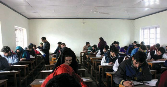 Class 12th students taking part in JKBOSE examination