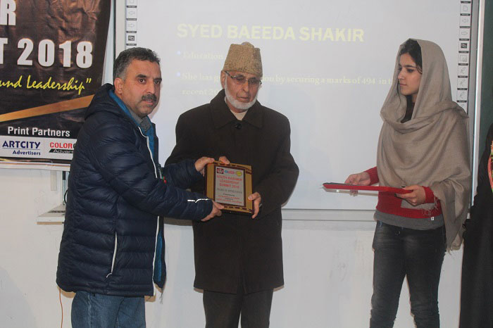 Chairman Rahim Greens, Abdul Hamid Bhat presenting awards at South Kashmir Leadership Summit 2018