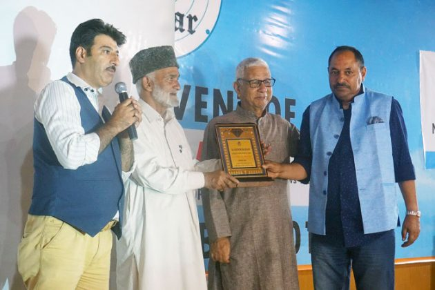 Bilal Bazaz (CNI Bureau Chief) presented with memento during the launch event
