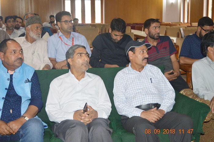 Bilal Bazaz (CNI Bureau Chief), G M Dar (DC Pulwama) and Professor Bashir Ahmad (Principal GDC Pulwama) among the audience during the launch event