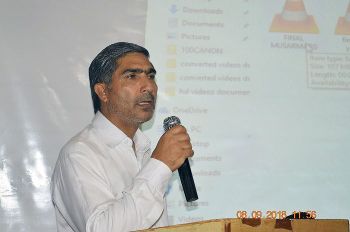 DC Pulwama, G M Dar speaking during the launch event