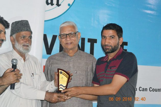 Radio Kashmir's Sports Correspondent, Muzaffar Dar presented with memento during the launch event