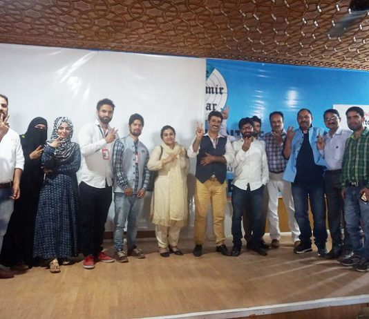 Team members of 'The Kashmir Radar' stand for a photograph along with guests during news portal's launch event